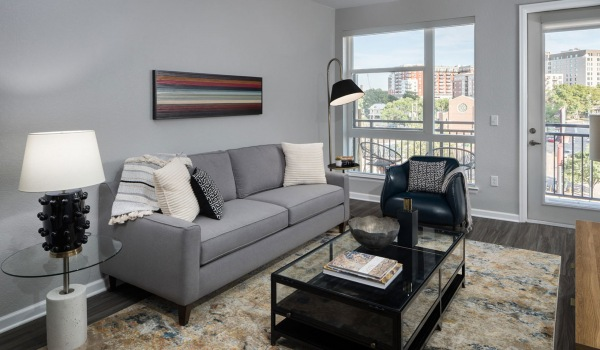 large windows in bright living room with access to private balcony